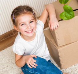 Little girl moving into new house
