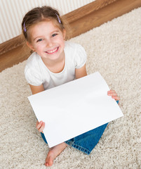 little girl with the sheet of paper