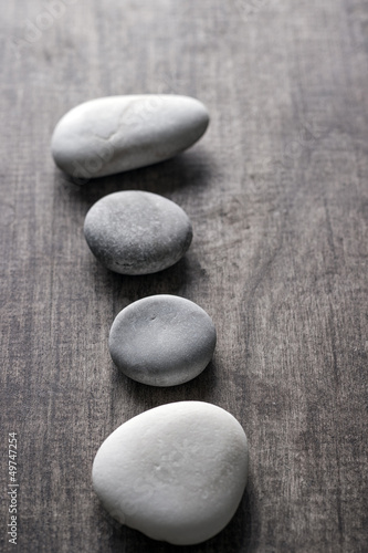 rocks on old wooden plank