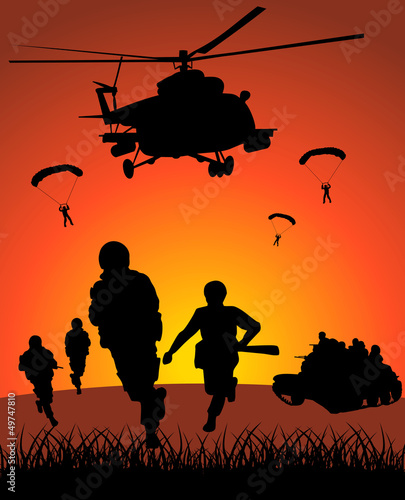Fotobehang Militair Military action against the sunset