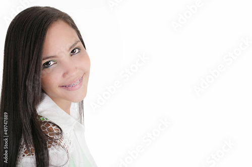 Cute Latina teenage girl smiling with braces on a white backgrou
