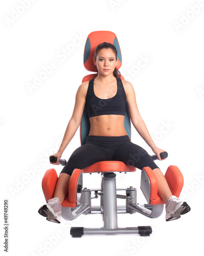 Sporty brunette on modern exerciser