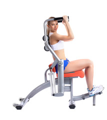Lovely woman training on hydraulic exerciser