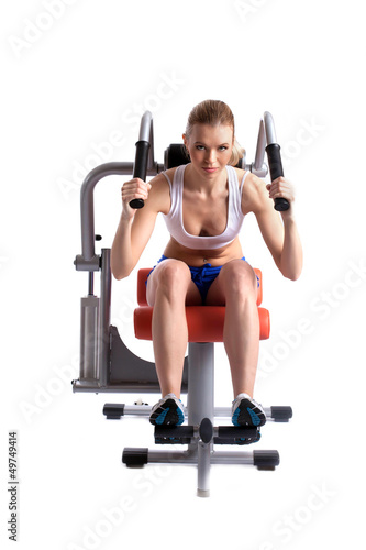 Athletic woman on hydraulic trainer