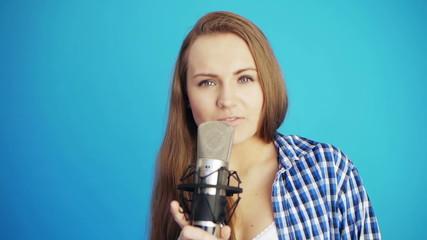 attractive woman singing song at studio
