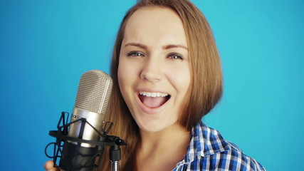 young woman singing a song at studio
