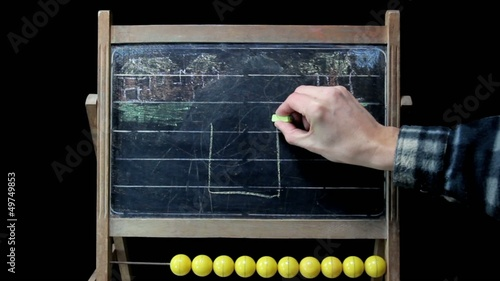 drawing house on blackboard