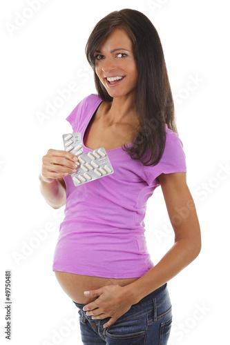 Glückliche Schwangere mit Tabletten - pregnant woman with pills