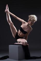beautiful blonde dancing on cube