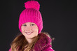 Pretty smiling Girl with knit cap
