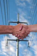 stretta di mano ed energia elettrica