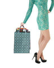 Female long legs in black shoes  and shopping gift bags.