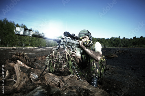 Special forces soldier with sniper rifle barrett m99