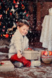 boy  with a basket of toys in the background of a beautiful Chri