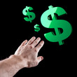 Green shiny USA dollar sign and man's hand over black background
