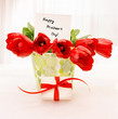 Red tulips with white giftbox