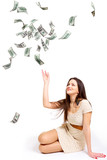 Young woman throwing money up isolated on white