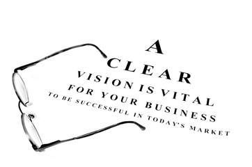 Eye glasses on exam chart for business success