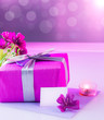 Pink present with flowers bouquet