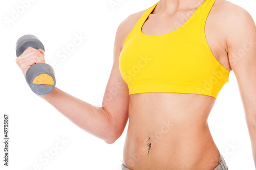 Female hand with a grey barbell, isolated on white