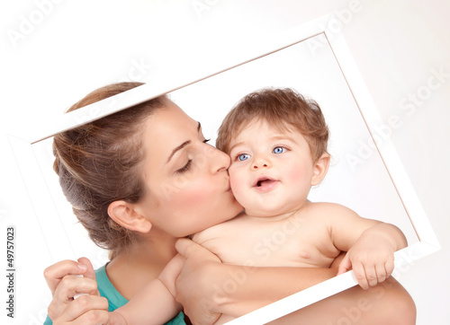 Mother kiss little son