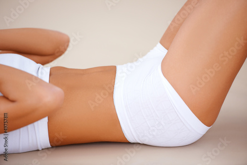 Body part of fit woman  she doing exercises