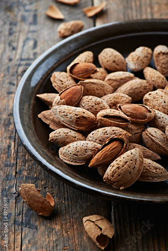 Almonds with shell on a ceramic plate