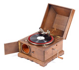 Angle view of old wooden gramophone against white background