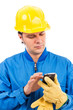 Portrait of a young construction worker using mobile phone