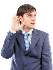 Young business man holding his hand to his ear