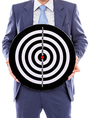 Businessman holding a dartboard