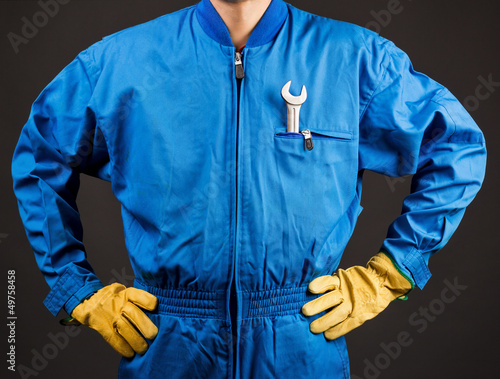 Construction worker with wrench in his pocket