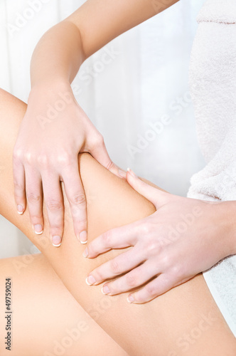 Woman squeezing her skin showing no problems