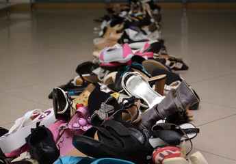 Pile of various female and male shoes in a store