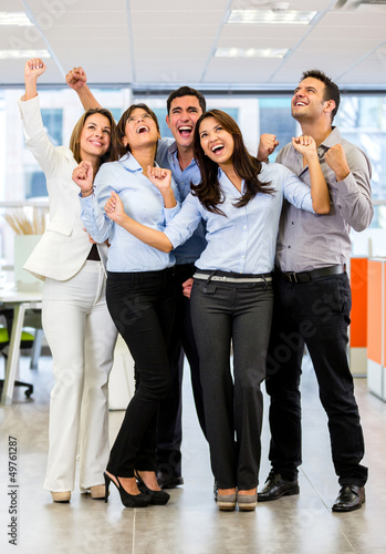 Business group with arms up