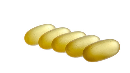 Yellow semi-transparent pills isolated on white background