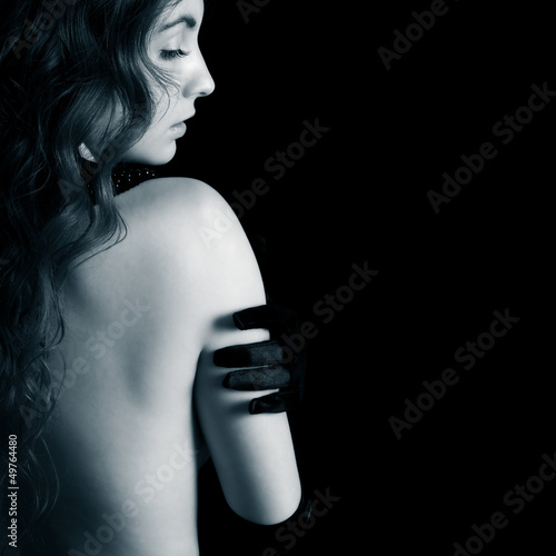 beautiful woman against dark background
