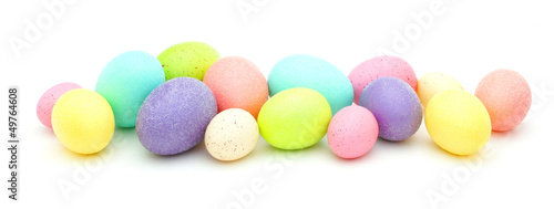 Horizontal border of colorful Easter eggs over white