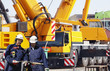 building-workers with giant mobile cranes