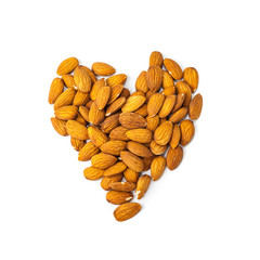 Heart shape of unshelled almonds on white