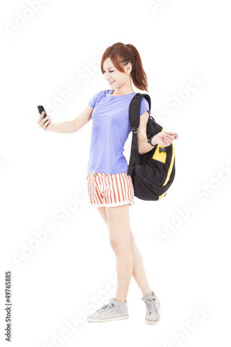 happy asian girl looking the smart phone in the hand