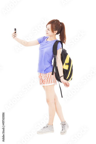 happy young woman looking the smart phone