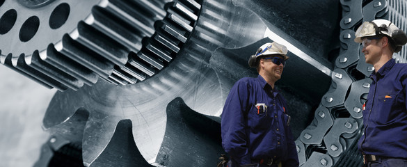 engineers with giant cog-machinery in background
