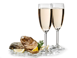 Two champagne glasses with two oysters