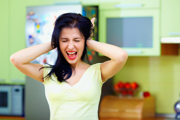 angry woman screaming in kitchen, home interior