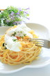 italian cuisine, poached egg on carbonara spaghetti