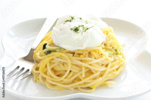 italian cuisine, poached egg on carbonara spaghetti
