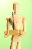 Mannequin with corkscrew, on green background