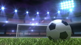 Football background, soccer ball on the grass at night stadium
