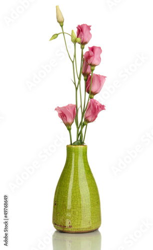 Bouquet of eustoma flowers in vase isolated on white